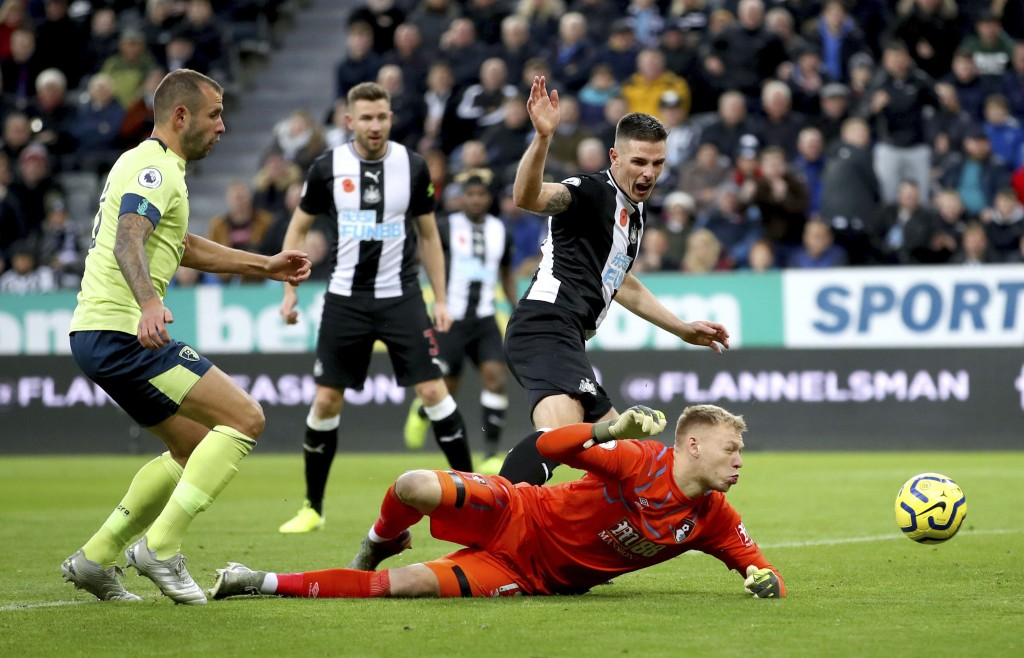 Newcastle United's Ciaran Clark scores his side's second goal of the game, during the English Premier League soccer match between Newcastle and Bourne...