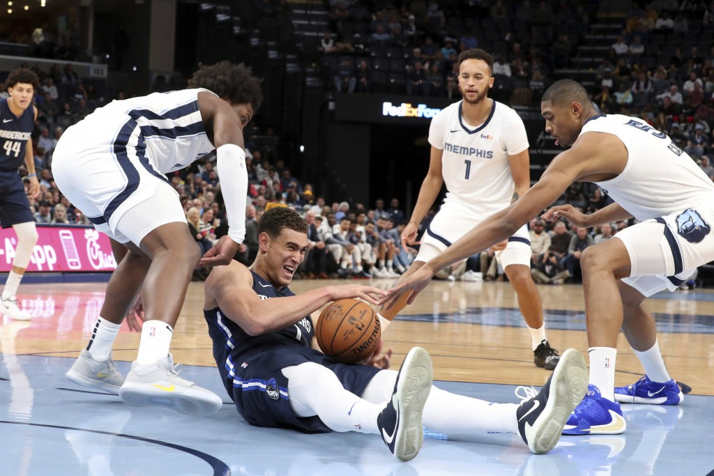 Memphis Grizzlies Bruno Caboclo (5) (rt) and Solomon Hill (44) defend against Dallas Mavericks' Dwight Powell (7) during the first half of an NBA bask...