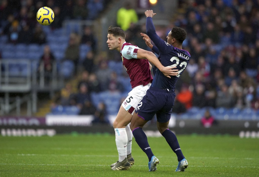 Burnley's James Tarkowski, left and West Ham United's Sebastien Haller battle for the ball during the English Premier League soccer match between Burn...