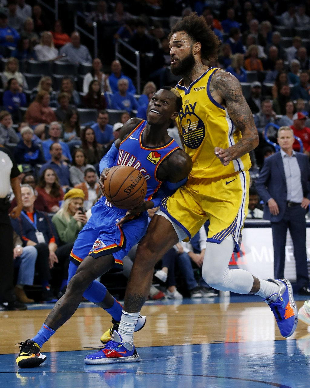 Oklahoma City Thunder's Dennis Schroder (17) drives the ball past Golden State Warriors' Willie Cauley-Stein (2) during the second half of an NBA bask...