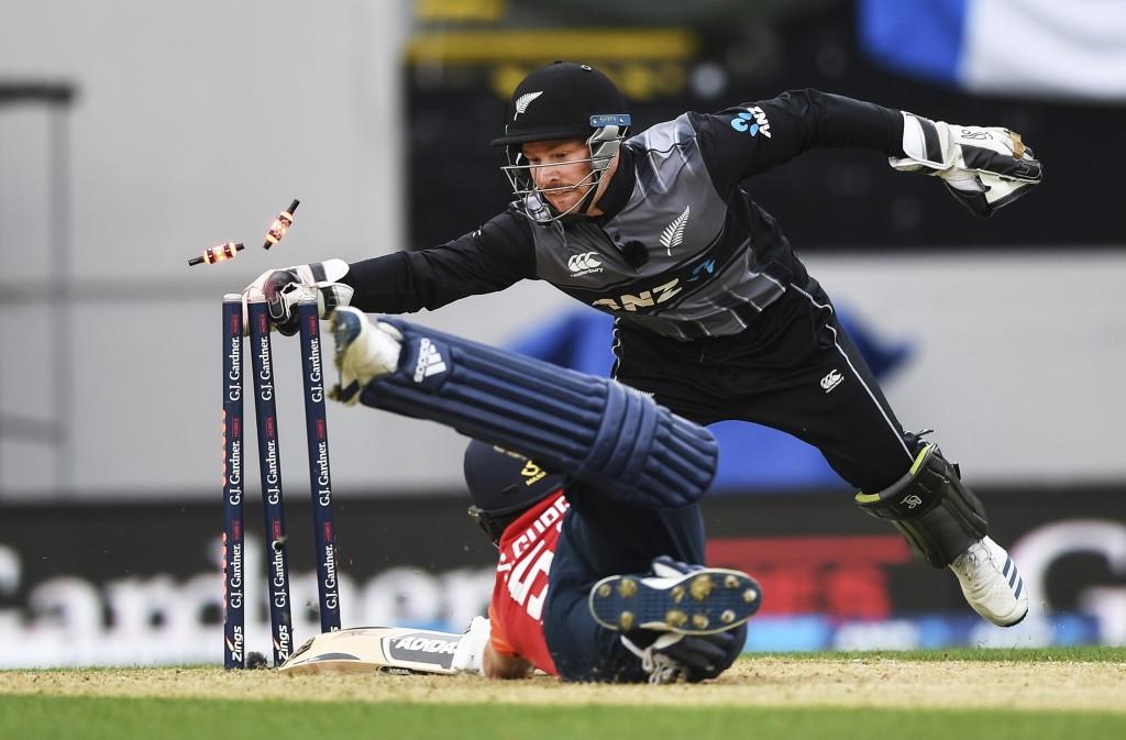 New Zealand wicket keeper Tim Seifert whips the bails off as he runs out England batsman Sam Curran during their T20 cricket match at Eden Park, Auckl...