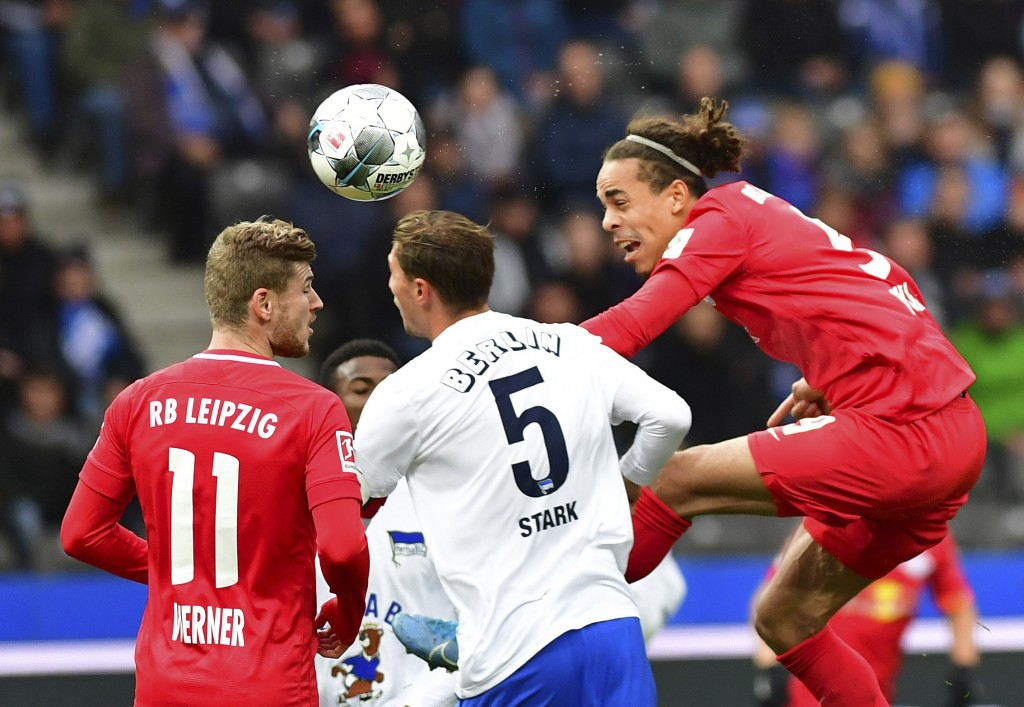 Leipzig's Yussuf Poulsen, right, Timo Werner, left, and and Berlin's Niklas Stark, center, challenge for the ball during the Bundesliga soccer match b...