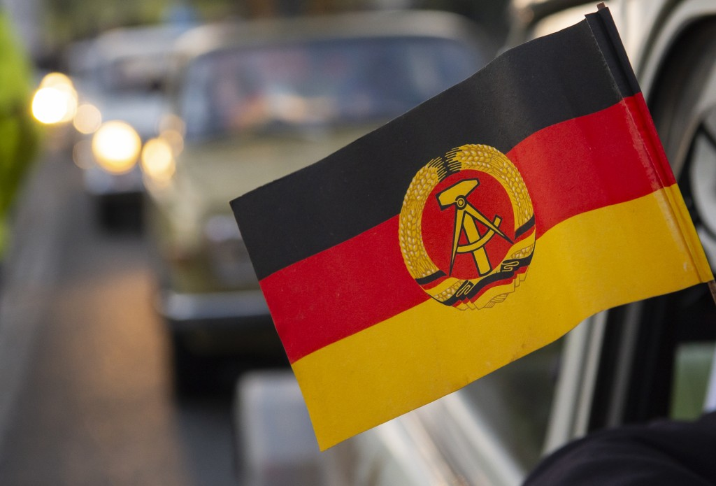 The flag of the former GDR hangs outside of a legendary GDR Trabant (Trabi) cars during a symbolic wall opening, celebrating the 30th anniversary of t...