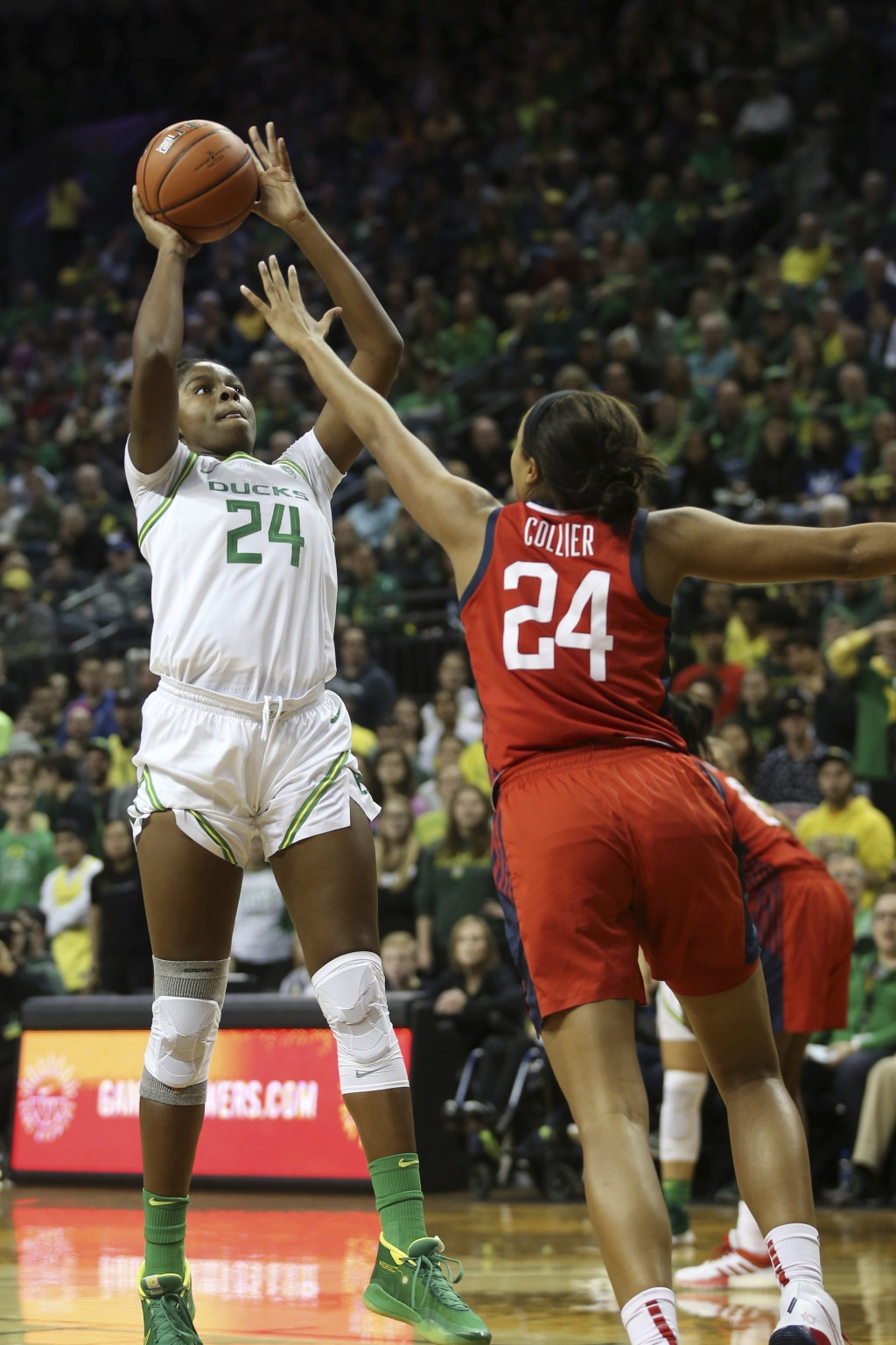 Oregon's Ruthy Hebard, left, shoots over United States' Napheesa Collier during the first half of an exhibition basketball game in Eugene, Ore., Satur...