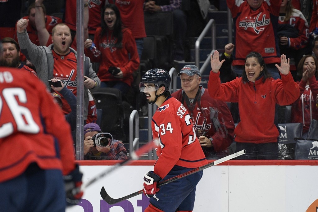 Washington Capitals defenseman Jonas Siegenthaler (34), of Switzerland, celebrates his goal during the second period of an NHL hockey game against the...