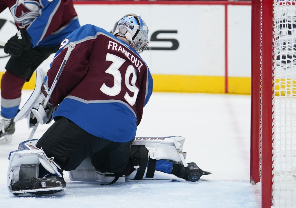 Colorado Avalanche goaltender Pavel Francouz (39) is scored on by Columbus Blue Jackets defenseman Zach Werenski during the first period of an NHL hoc...