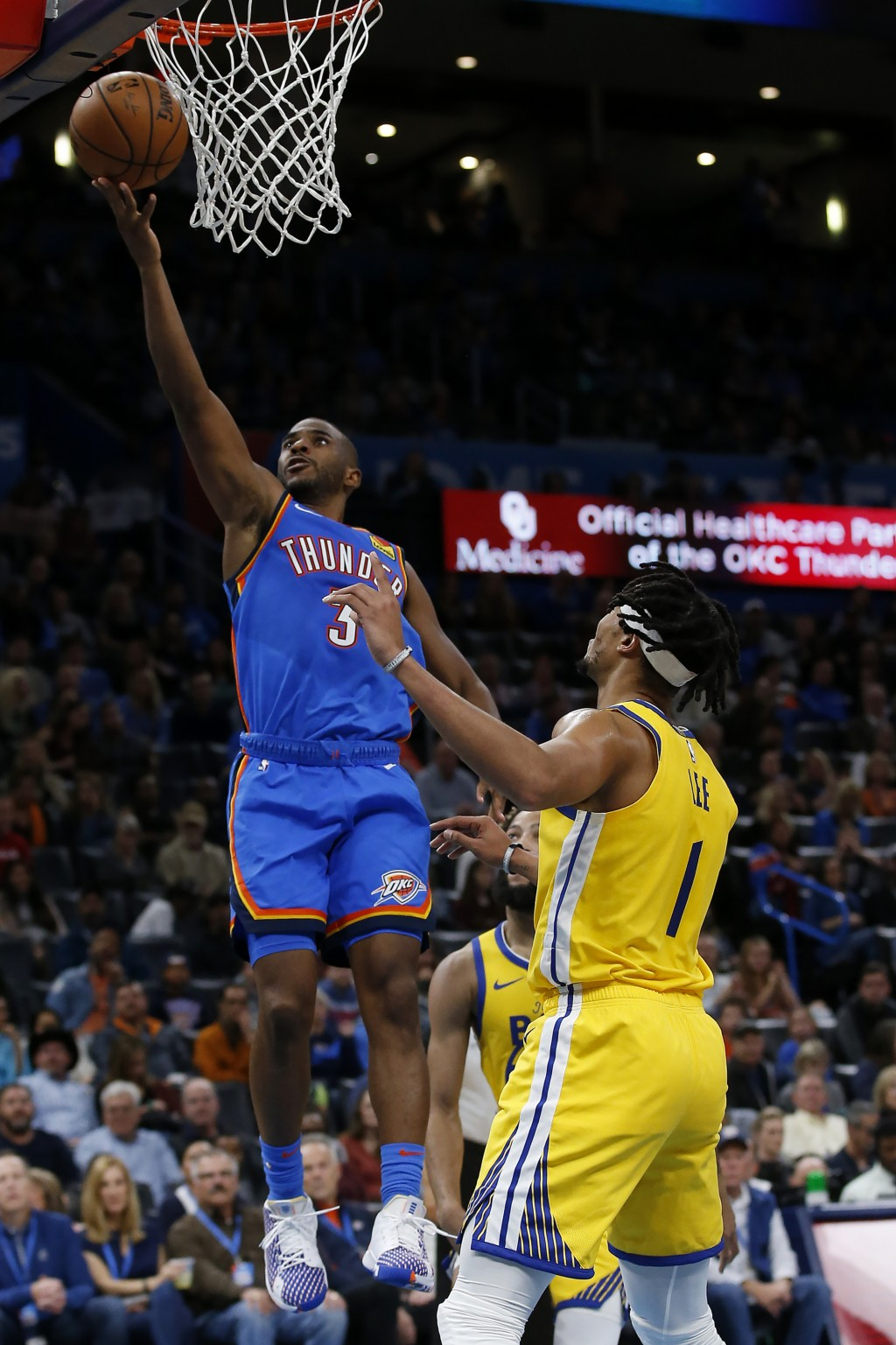 Oklahoma City Thunder's Chris Paul (3) shoots against Golden State Warriors' Damion Lee (1) and Ky Bowman (12) during the second half of an NBA basket...