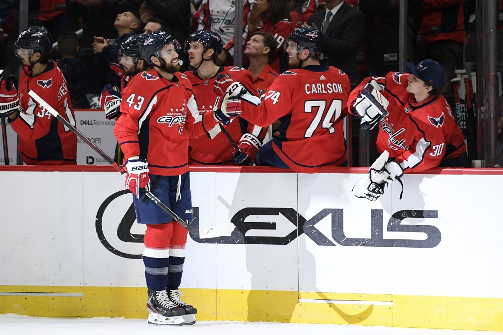 Washington Capitals right wing Tom Wilson (43) celebrates his goal during the first period of the team's NHL hockey game against the Vegas Golden Knig...