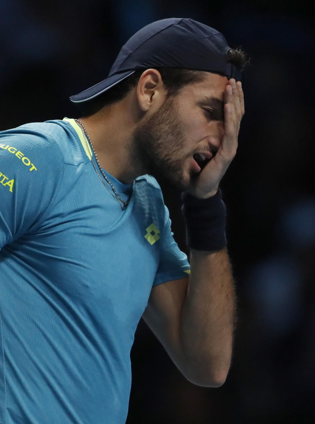 Italy's Matteo Berrettini reacts after missing a shot as he plays against Serbia's Novak Djokovic during their ATP World Tour Finals singles tennis ma...