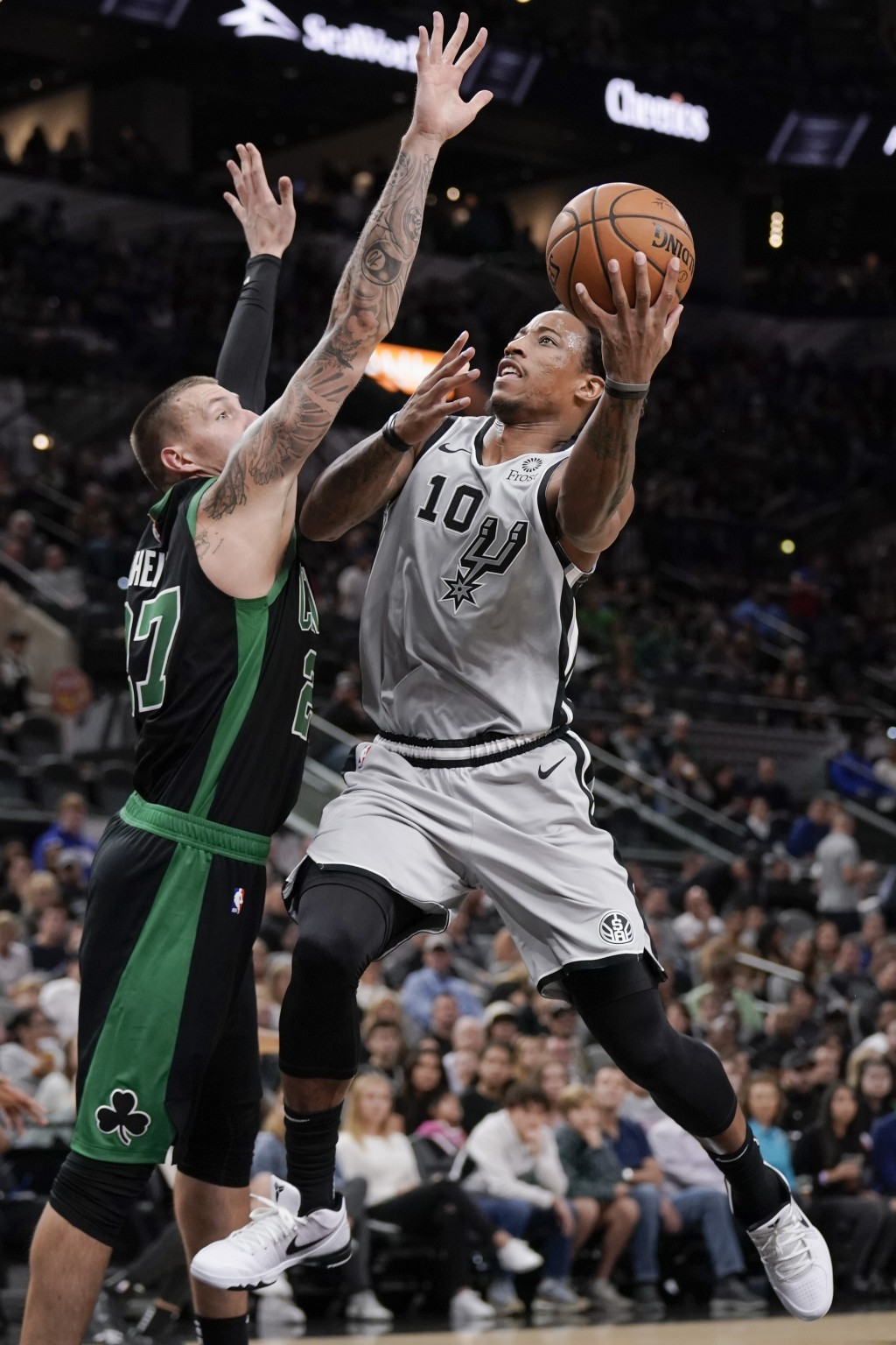San Antonio Spurs' DeMar DeRozan (10) shoots against Boston Celtics' Daniel Theis during the first half of an NBA basketball game, Saturday, Nov. 9, 2...
