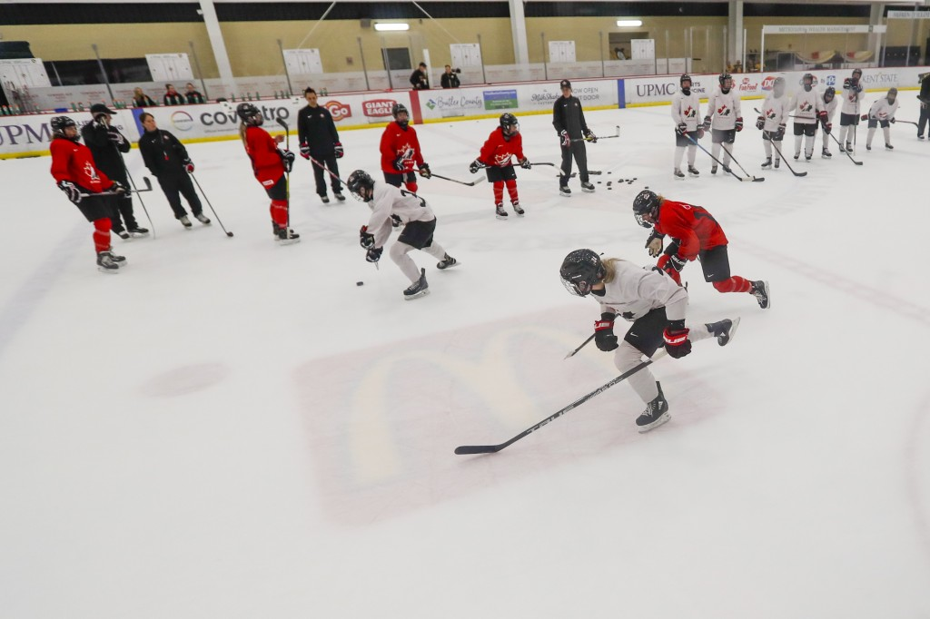 In this photo  taken Monday, Nov. 4, 2019, members of the Canada Women's National hockey team drill during their practice in Cranberry Township, Butle...