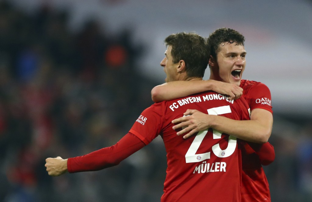 Bayern's Thomas Mueller, front, and Bayern's Benjamin Pavard celebrate at the end of the German Bundesliga soccer match between FC Bayern Munich and B...