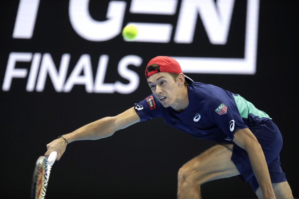 Alex De Minaur of Australia returns the ball to Jannik Sinner of Italy, during the ATP Next Gen tennis tournament final match, in Milan, Italy, Saturd...