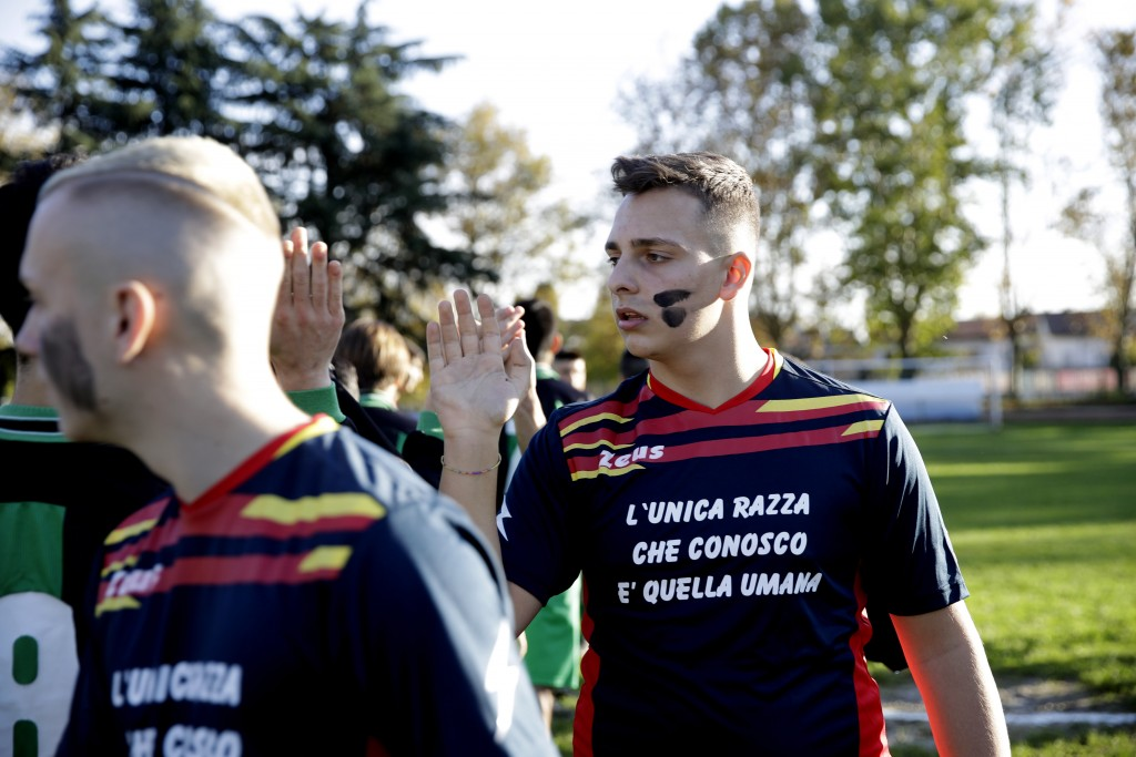 Desio players, their faces painted with black marks and wearing jerseys reading ' The only race I know is the human race 'as a symbolic sign against r...