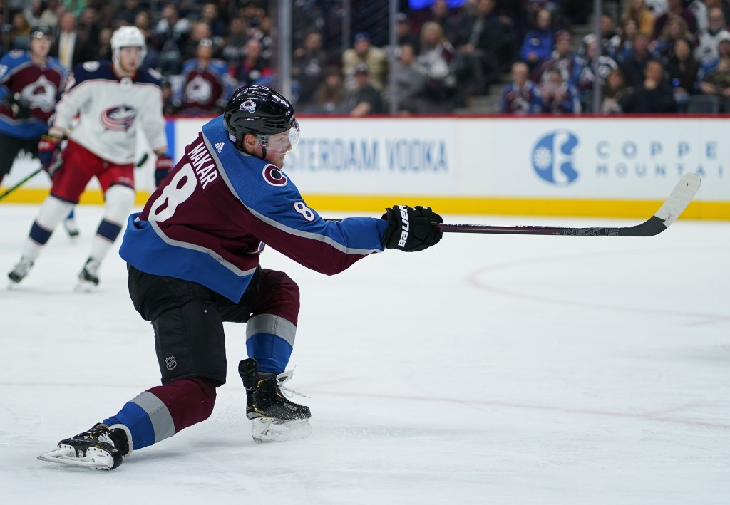 Colorado Avalanche defenseman Cale Makar (8) shoots a goal against the Columbus Blue Jackets during the second period of an NHL hockey game, Saturday,...