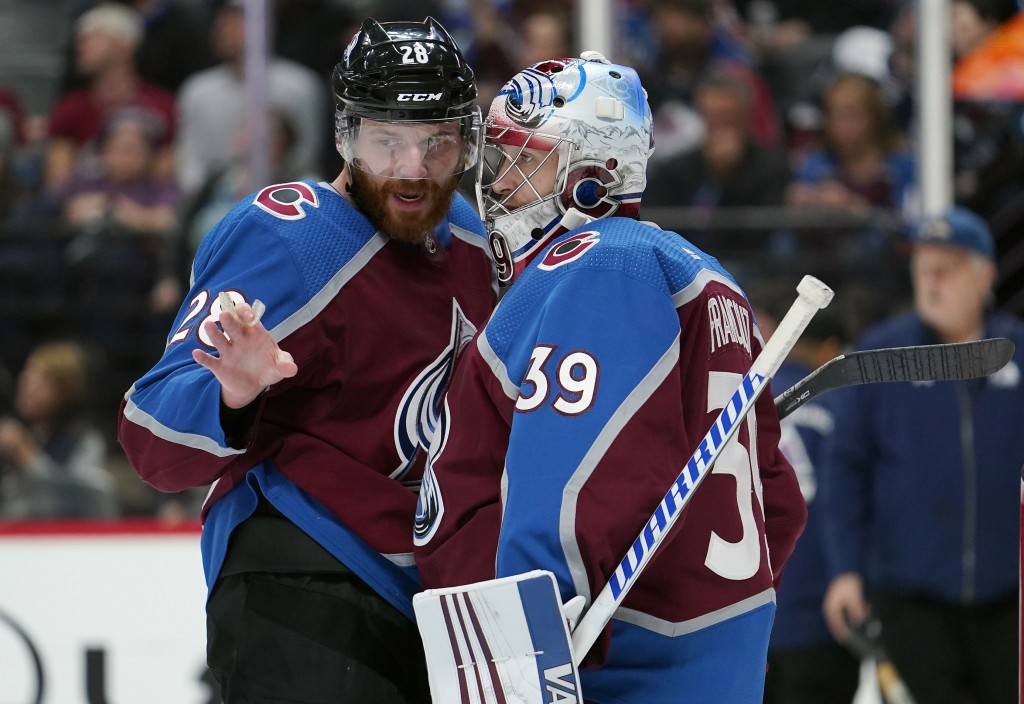 Colorado Avalanche defenseman Ian Cole (28) talks with goal tender Pavel Francouz (39) during the third period of an NHL hockey game against the Colum...