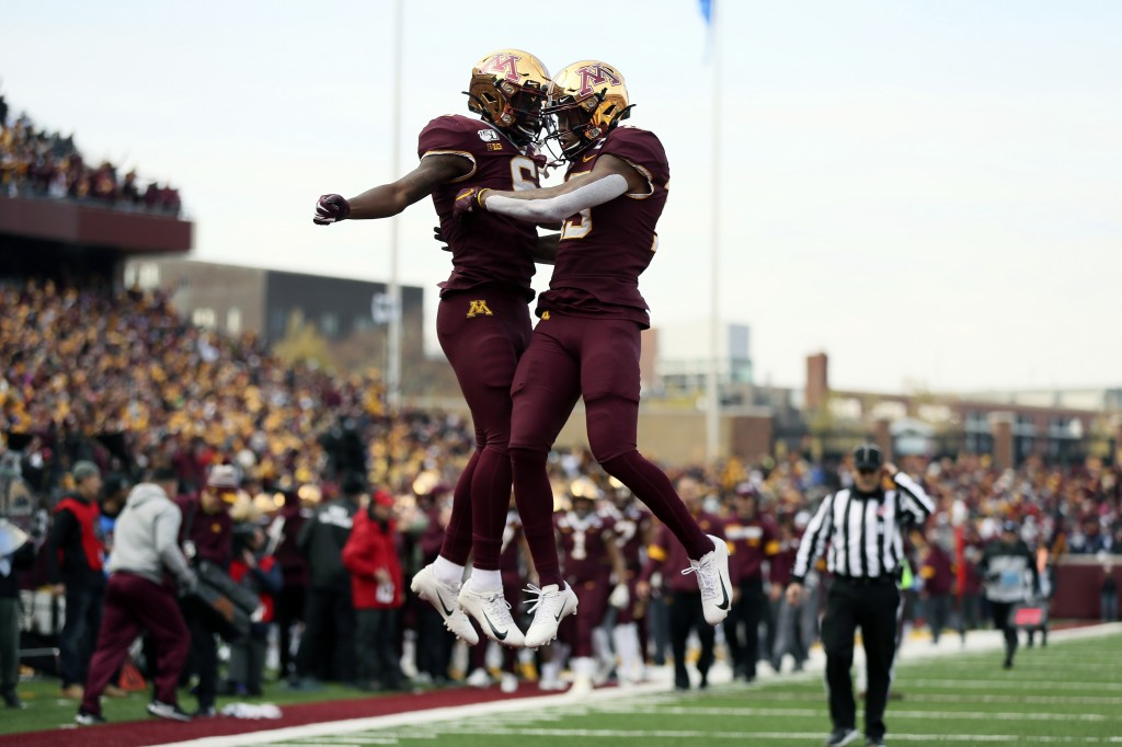 Minnesota wide receiver Rashod Bateman, right, jumps up in celebration with teammate Tyler Johnson after Bateman scored a touchdown against Penn State...