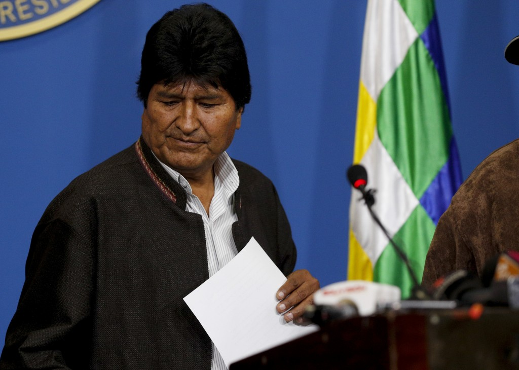 Bolivia's President Evo Morales looks down during a press conference in La Paz, Bolivia, Sunday, Nov. 10, 2019. Morales is calling for new presidentia...