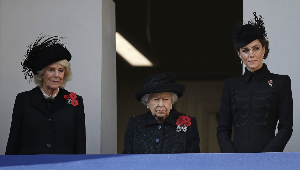 Britain's Queen Elizabeth II Kate Duchess of Cambridge right and Camilla Duchess of Cornwall attend the Remembrance Sunday ceremony at the Cenot