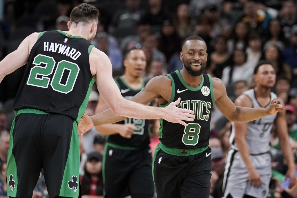 Boston Celtics' Kemba Walker (8) and Gordon Hayward celebrate a basket during the first half of an NBA basketball game against the San Antonio Spurs, ...