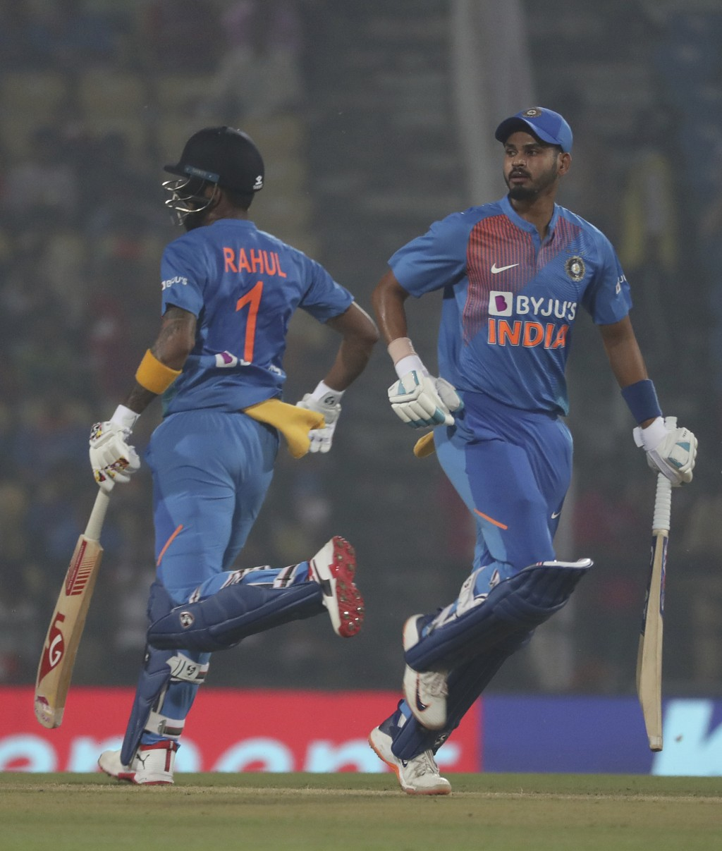 India's Shreyas Iyer, right, along with K.L.Rahul runs between the wicket during third Twenty20 international cricket match against Bangladesh in Nagp...