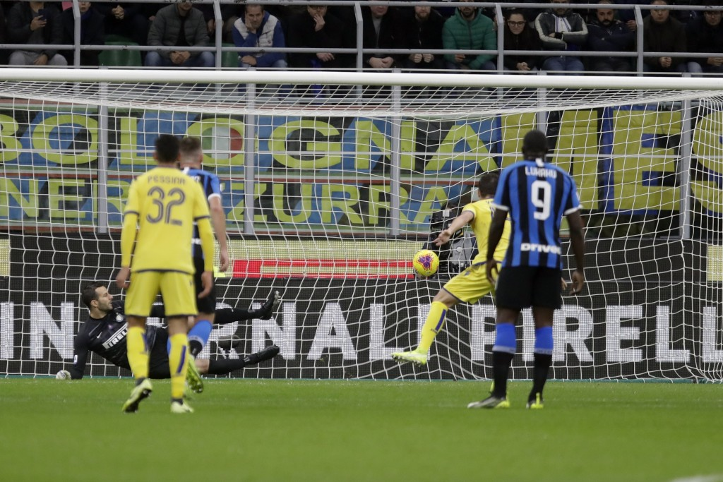 Verona's Valerio Verre scores his side's opening goal on a penalty kick, during the Serie A soccer match between Inter Milan and Hellas Verona, at the...