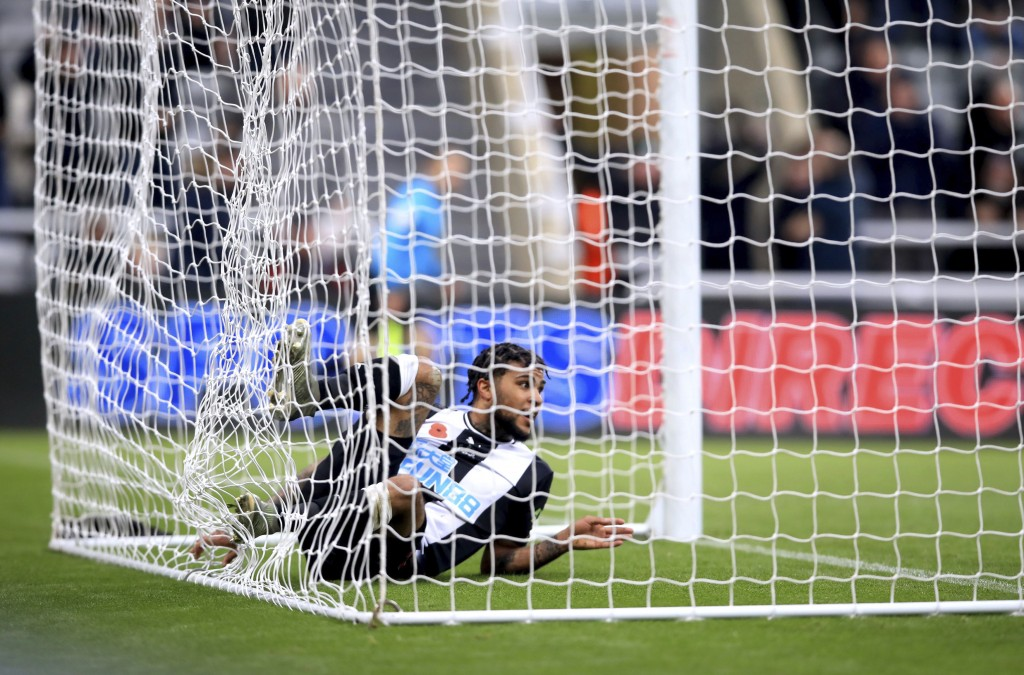 Newcastle United's DeAndre Yedlin scores his side's first goal of the game, during the English Premier League soccer match between Newcastle and Bourn...