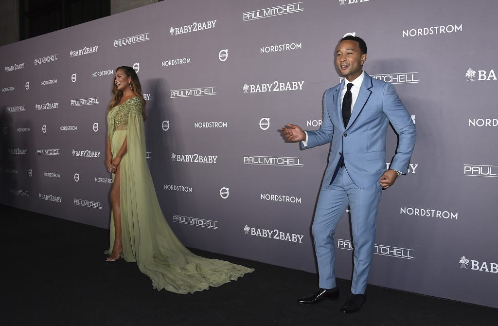 John Legend, right, and Chrissy Teigen arrive at the 2019 Baby2Baby Gala on Saturday, Nov. 9, 2019, in Culver City, Calif. (Photo by Jordan Strauss/In...