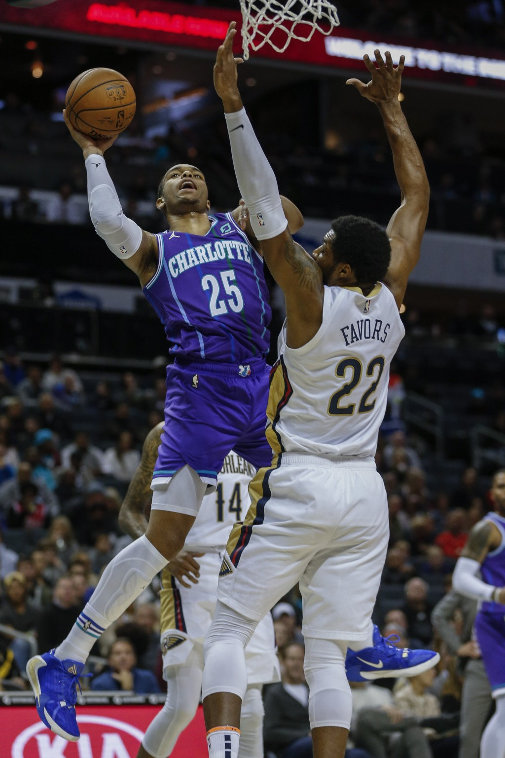 Charlotte Hornets forward P.J. Washington, left, shoots against New Orleans Pelicans center Derrick Favors in the first half of an NBA basketball game...