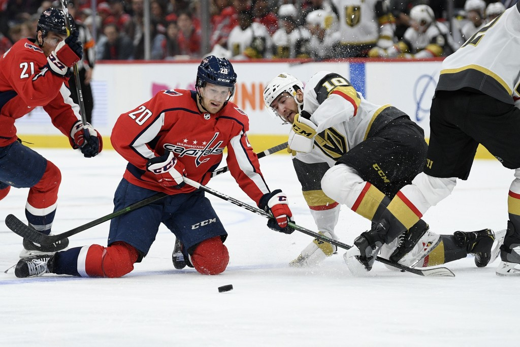 Washington Capitals center Lars Eller (20), of Denmark, and Vegas Golden Knights center Nicolas Roy (10) battle for the puck during the second period ...
