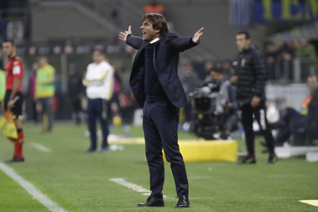 Inter Milan's head coach Antonio Conte opens his arms during the Serie A soccer match between Inter Milan and Hellas Verona, at the San Siro stadium i...