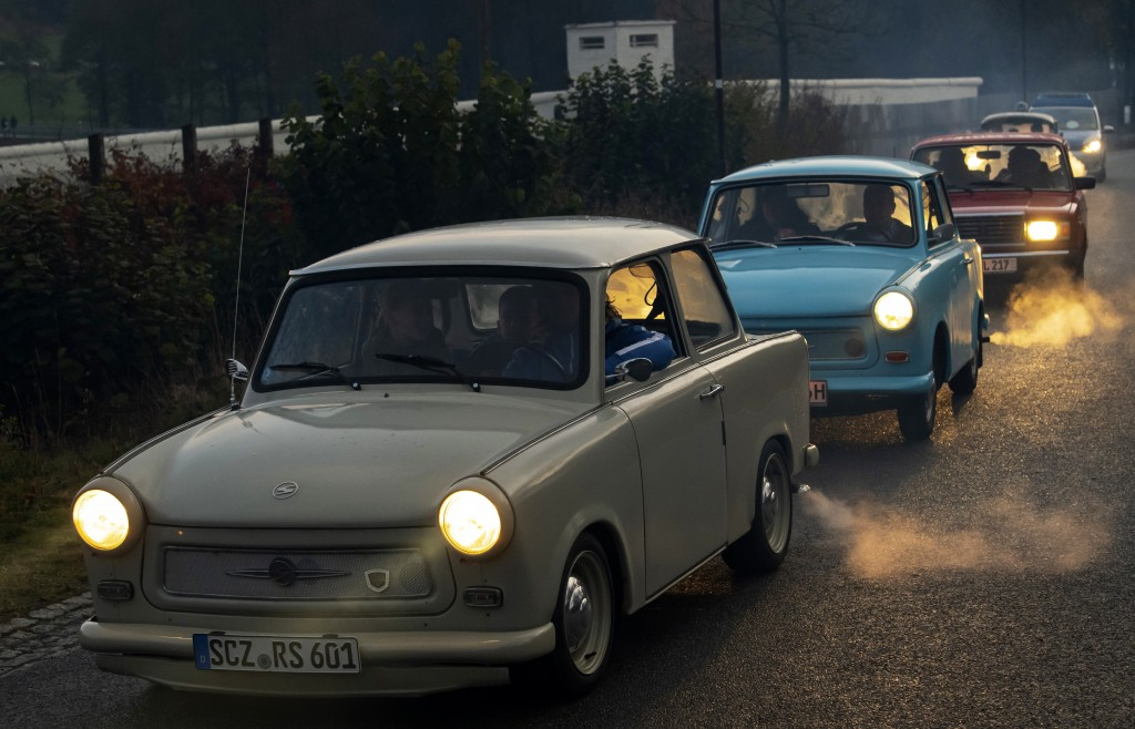 The legendary GDR Trabant (Trabi) cars drive along,  during a symbolic wall opening, celebrating the 30th anniversary of the falling wall in the outdo...