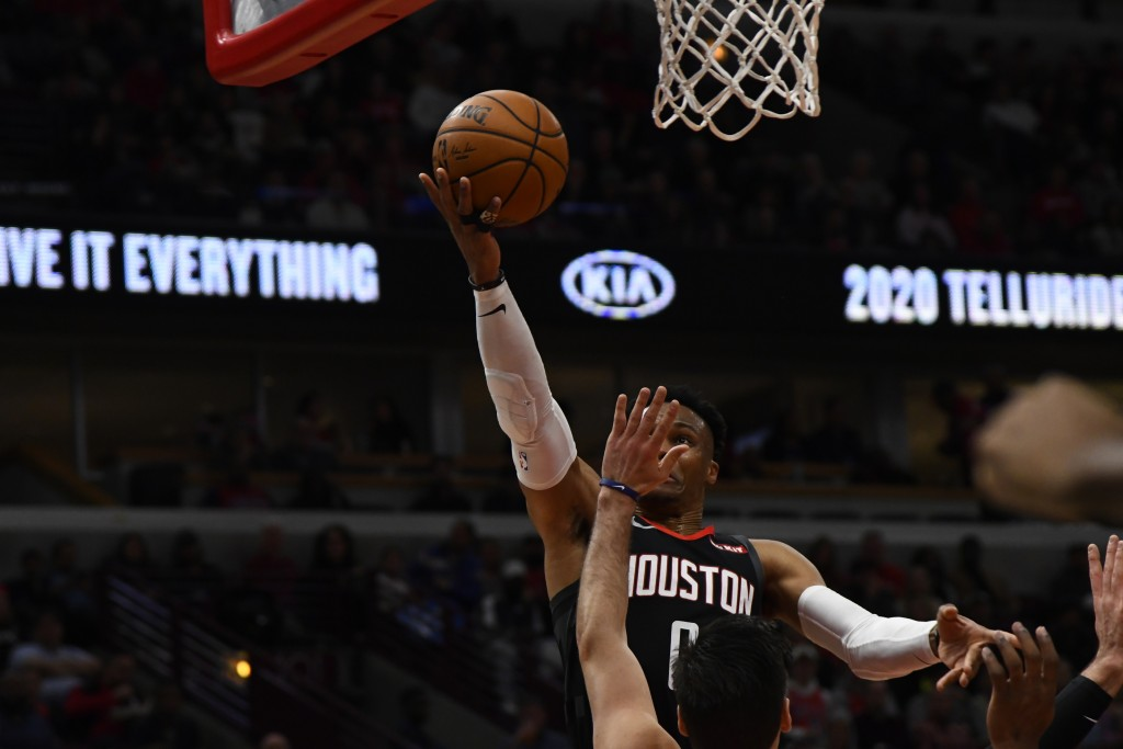 Houston Rockets guard Russell Westbrook (0) shoots against the Chicago Bulls during the first half of an NBA basketball game Saturday Nov. 9, 2019, in...