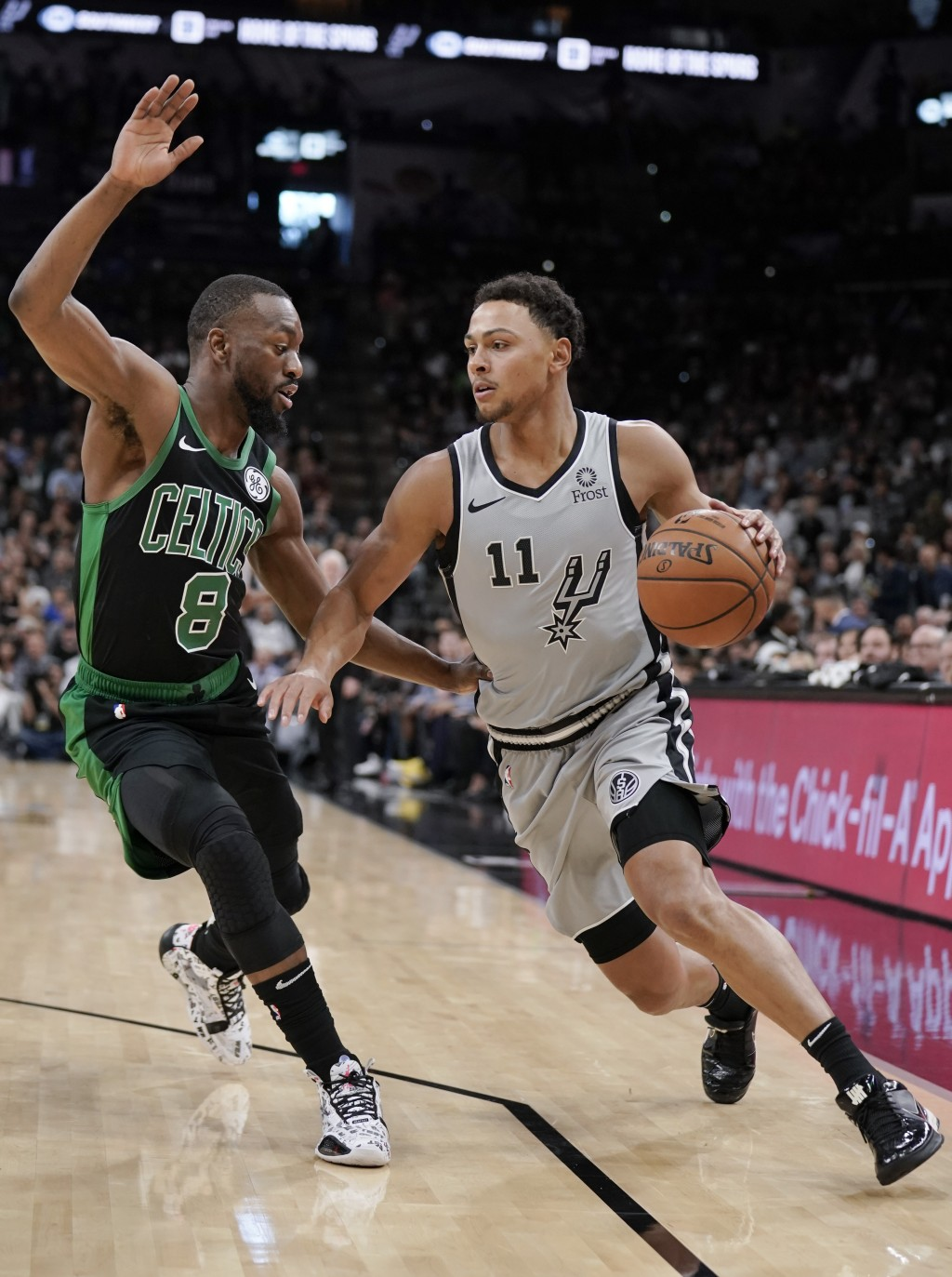 San Antonio Spurs' Bryn Forbes (11) drives against Boston Celtics' Kemba Walker during the first half of an NBA basketball game, Saturday, Nov. 9, 201...