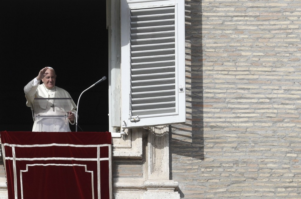 Pope Francis delivers his blessing during his Angelus prayer from his studio window overlooking St. Peter's Square, at the Vatican, Sunday, Nov. 10, 2...