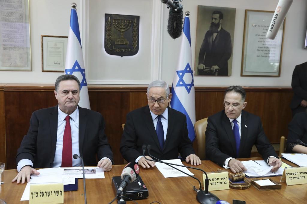 Israeli Prime Minister Benjamin Netanyahu center, Foreign Minister Israel Katz, left, and the government secretary Tzachi Braverman, attend the weekly...