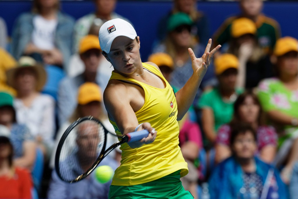Australia's Ash Barty plays a shot to France's Kristina Mladenovic during their Fed Cup tennis final in Perth, Australia, Sunday, Nov. 10, 2019. (AP P...