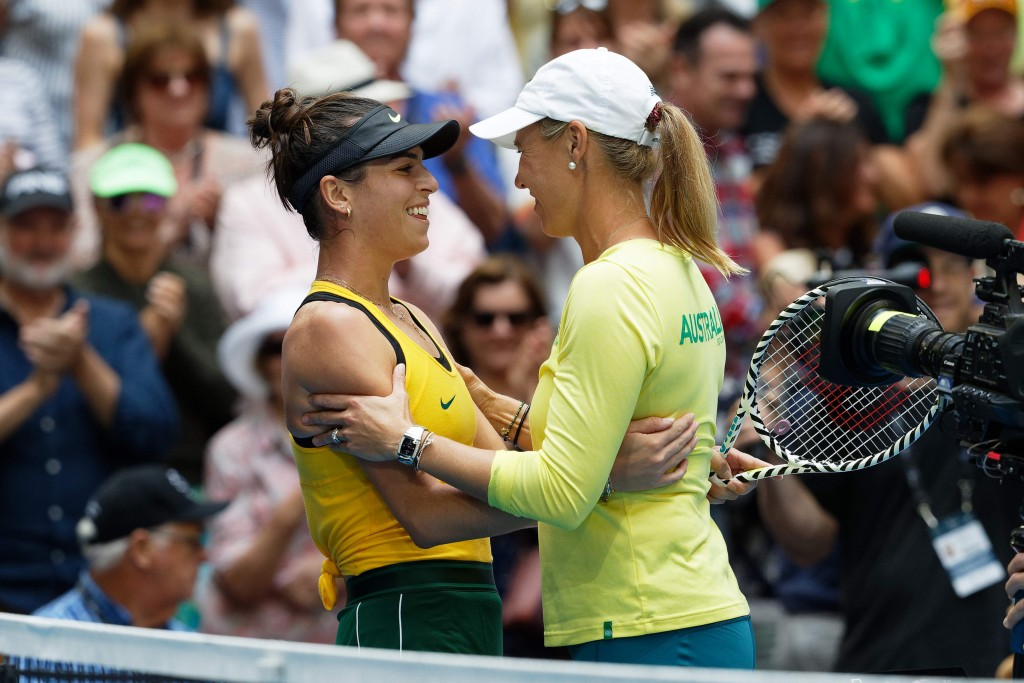 Australia's Ajla Tomljanovic, left, is hugged by Australian captain Alicia Molik after winning her match against France's Pauline Parmentier during th...