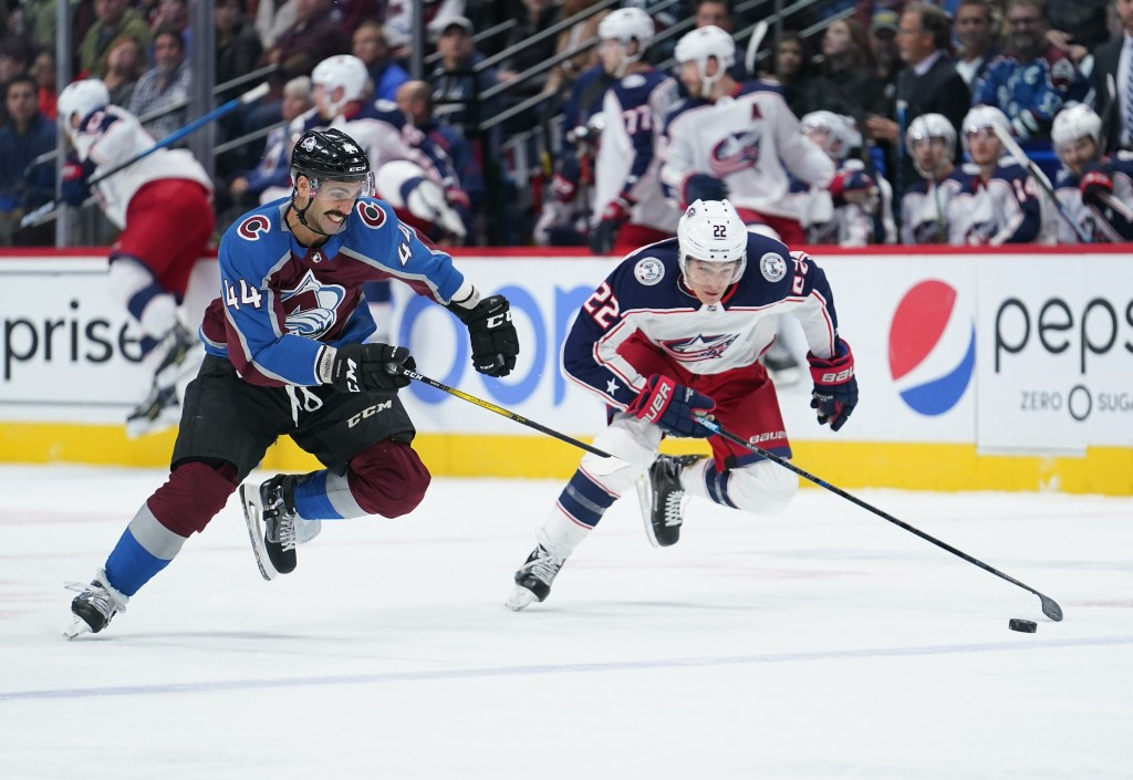 Colorado Avalanche defenseman Mark Barberio (44) and Columbus Blue Jackets left wing Sonny Milano (22) chase the puck during the first period of an NH...