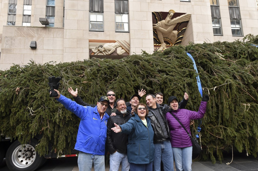 IMAGE DISTRIBUTED FOR TISHMAN SPEYER -  Carol Schultz, center, donor of this year's Rockefeller Center Christmas tree, poses with her family in front ...
