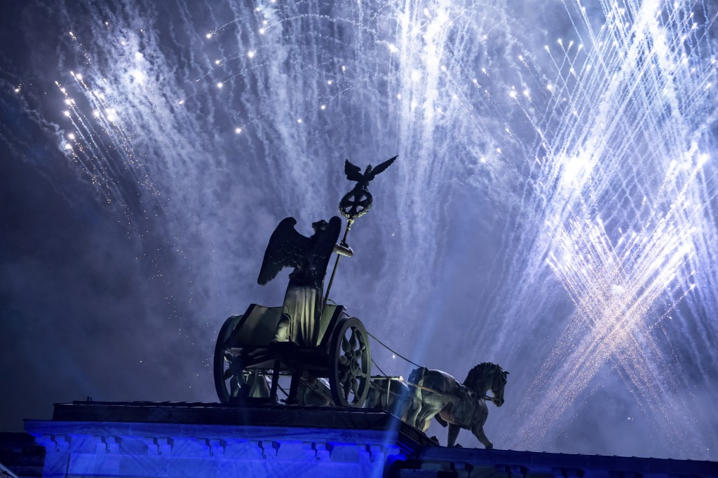 Fireworks are seen over the Brandenburg Gate as part of the 30th anniversary of the fall of the Berlin Wall in Berlin, Germany, Saturday, Nov. 9, 2019...
