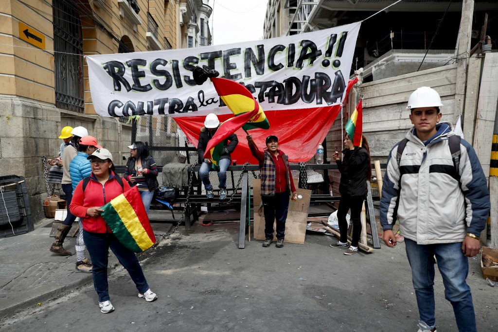Anti-government protesters block a street meters away from the presidential palace in La Paz, Bolivia, Sunday, Nov. 10, 2019. President Evo Morales is...