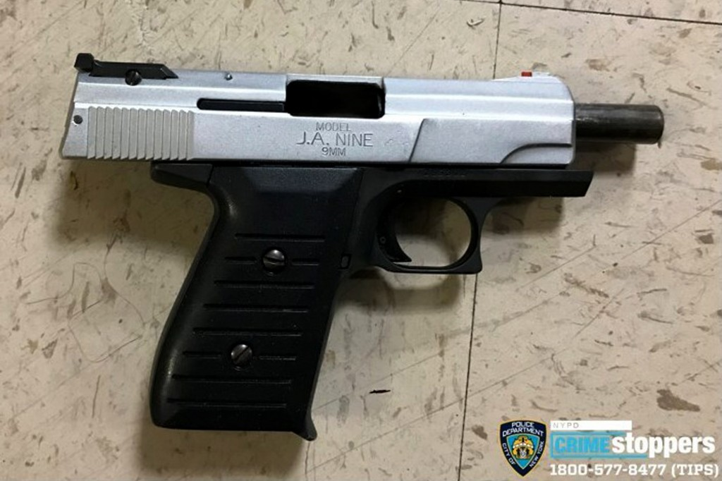 FILE - This Oct. 23, 2019 file photo provided by the New York Police Department shows a firearm recovered at the scene where police shot and killed a ...