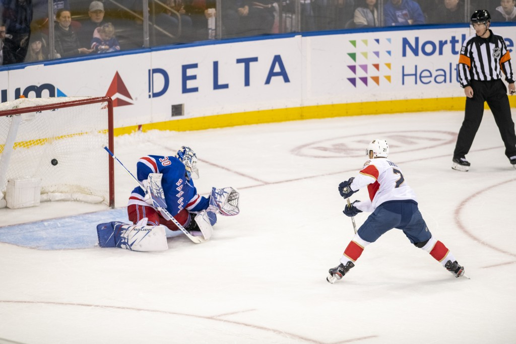 Florida Panthers center Vincent Trocheck (21) scores the winning goal on New York Rangers goaltender Henrik Lundqvist (30) during a shootout of a NHL ...