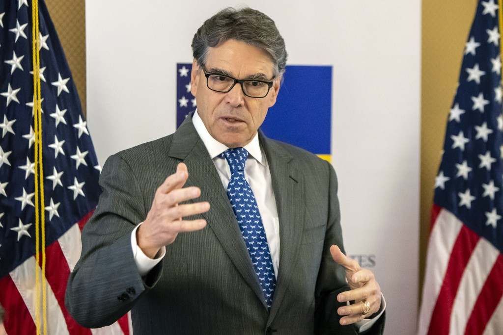 In this Nov. 12, 2018, photo provided by the U.S. Embassy in Kyiv, Energy Secretary Rick Perry speaks in Kyiv, Ukraine. Michael Bleyzer and Alex Cranb...