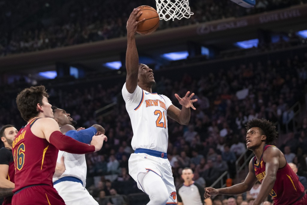 New York Knicks guard Damyean Dotson (21) goes to ...