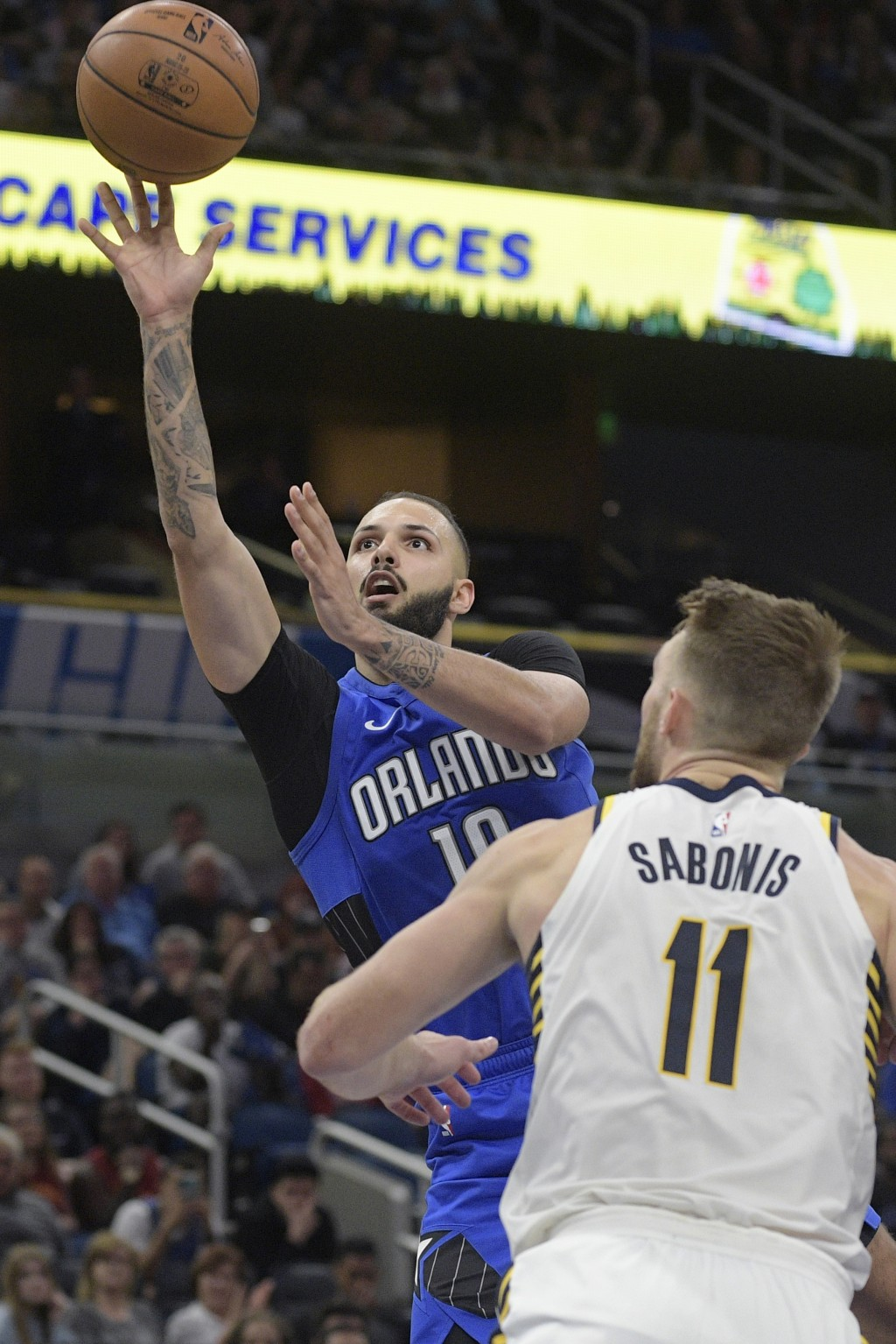 Orlando Magic guard Evan Fournier (10) goes up to shoot in front of Indiana Pacers forward Domantas Sabonis (11) during the second half of an NBA bask...