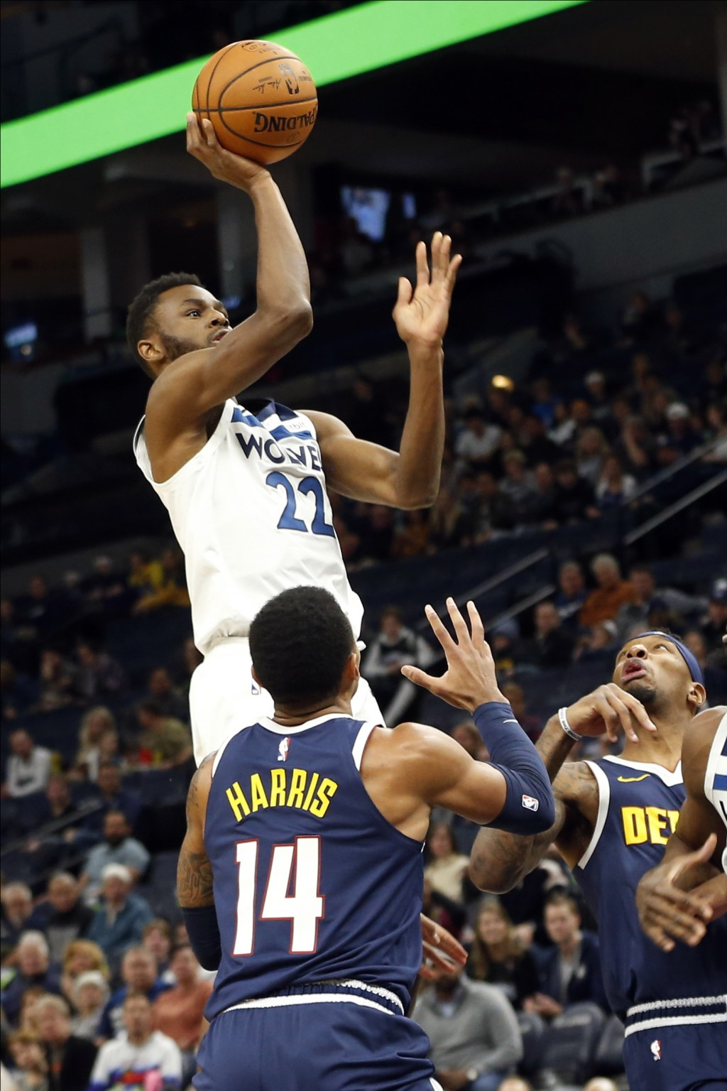 Minnesota Timberwolves' Andrew Wiggins shoots in front of Denver Nuggets' Gary Harris during the first half of an NBA basketball game Sunday, Nov. 10,...