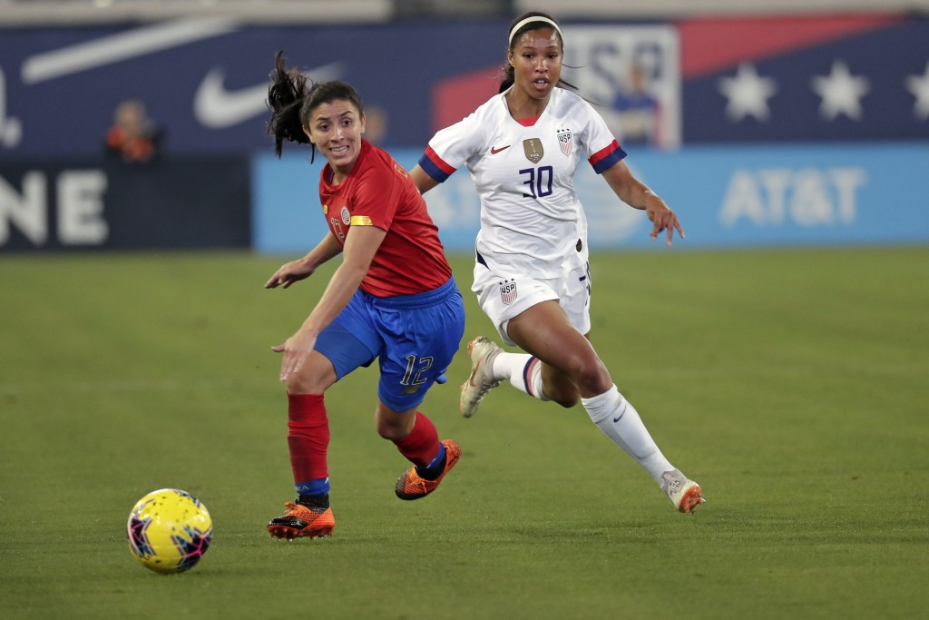 Costa Rica's Lixy Rodriguez, left, moves the ball away from U.S. forward Margaret Purce (30) during the first half of an international friendly soccer...