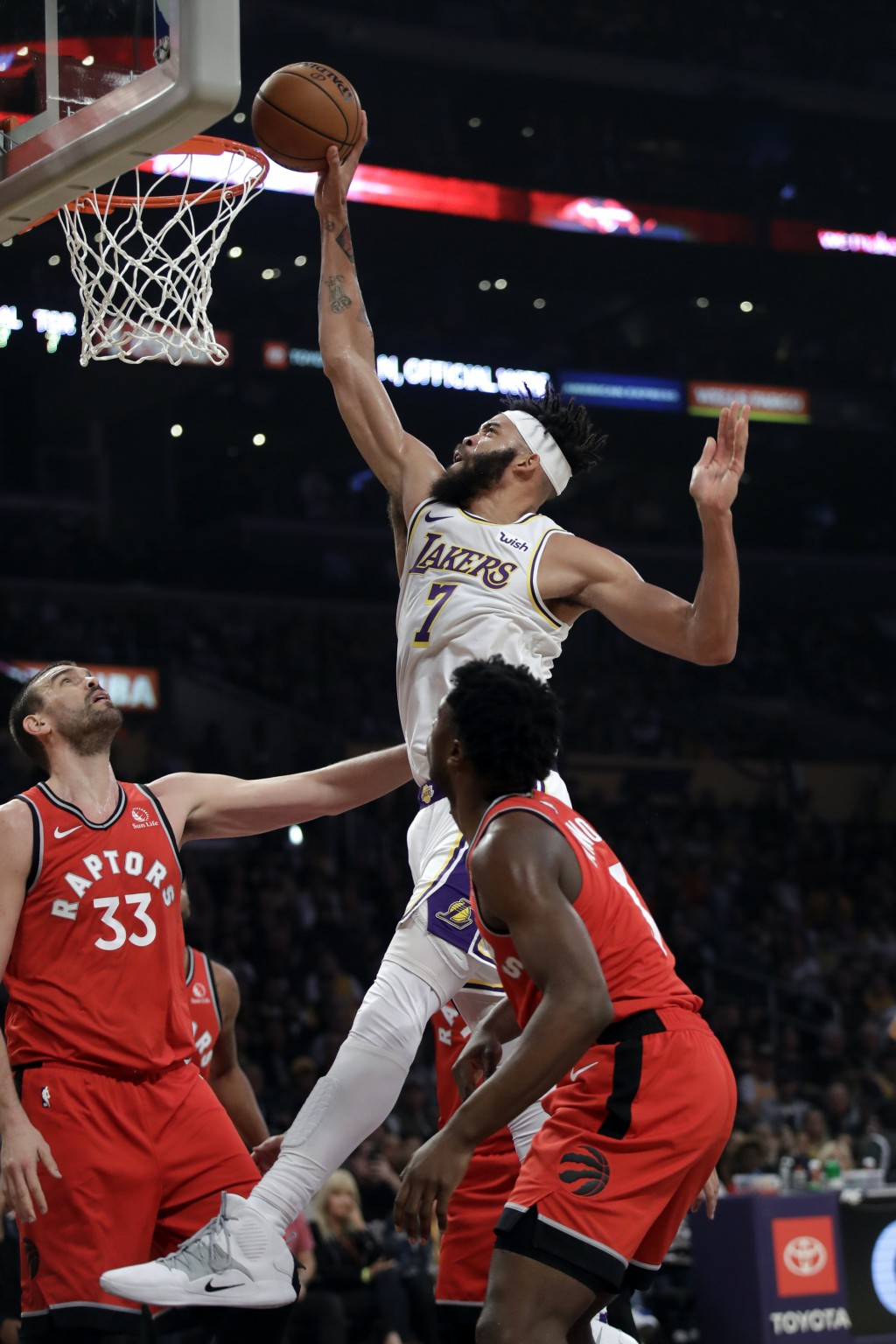 Los Angeles Lakers' JaVale McGee (7) dunks over Toronto Raptors' Marc Gasol (33) during the first half of an NBA basketball game Sunday, Nov. 10, 2019...